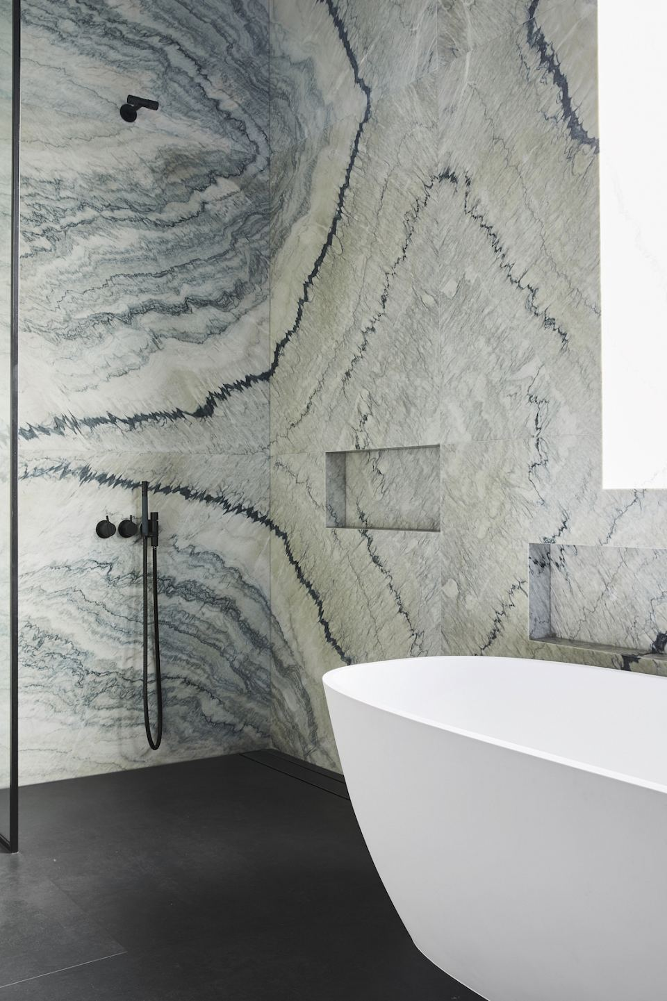 Lavanza Honed bathroom walls at van Haandel and Williams Pott's Point home. Photography by Anson Smart..jpg