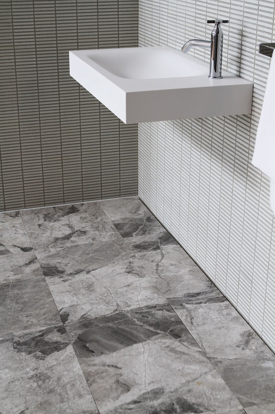 Teragio honed tiles to floor with INAX Yohen Border mosaic and 815 AgapeBasin.jpg