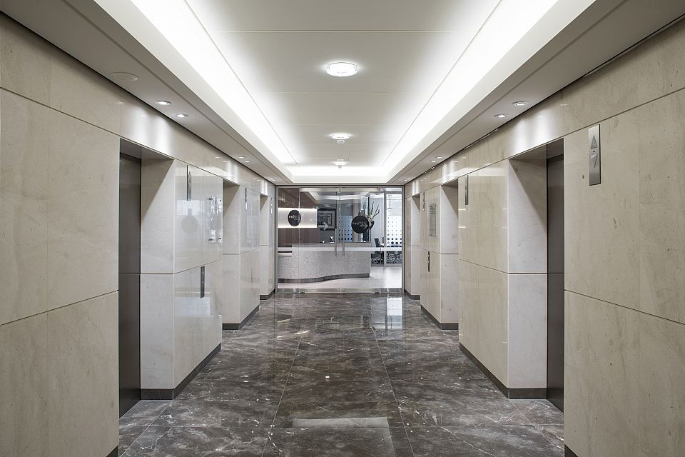 Grigio Imperiale Polished floor and Rocca Bianca Polished walls. Angel Place, Sydney.jpg